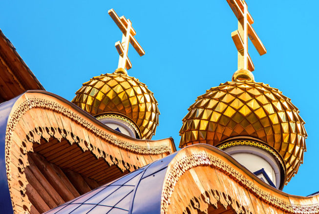 Domes with crosses on wooden orthodox church in Samara, Russia