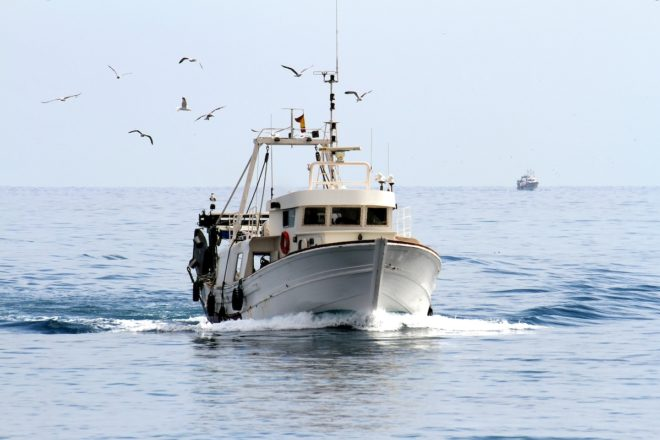 Trawler,Fishing,Boat,Sailing,In,Open,Waters
